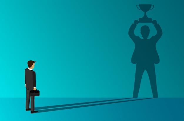 Empresário que uma sombra em pé segurando um troféu de sucesso na parede Vetor Premium