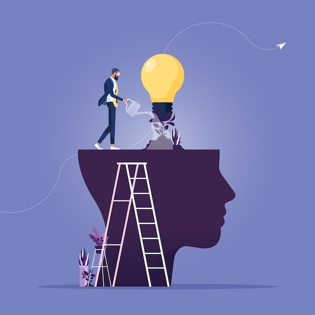 Empresário regando do cérebro aquela planta lâmpada em crescimento como uma personalidade de crescimento em metáfora Vetor Premium