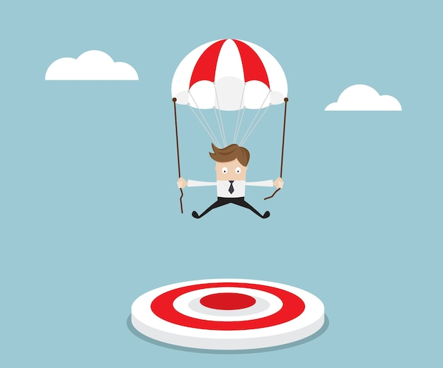 Empresário voando com pára-quedas para o alvo Vetor Premium