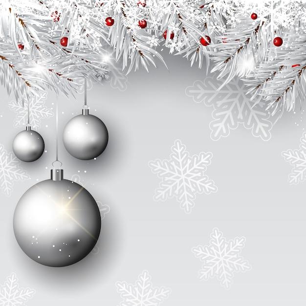 Enfeites de natal em ramos de prata Vetor grátis