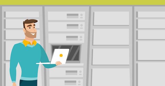 Engenheiro trabalhando no laptop na sala de servidores de rede. Vetor Premium