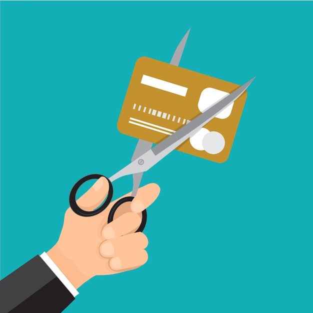Entregue o cartão de crédito do corte do negócio com scissor. Vetor Premium