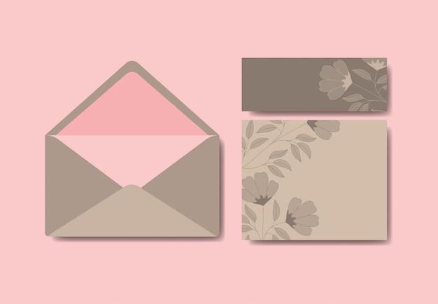 Envelope com convite e decoração floral Vetor grátis