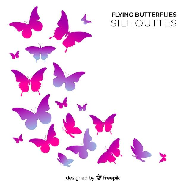 Enxame de silhuetas de borboleta Vetor grátis