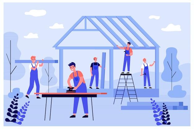 Equipe de carpinteiros profissionais fazendo estruturas de parede e telhado Vetor Premium