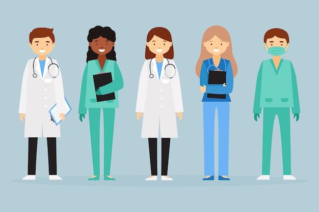 Equipe profissional de saúde em pé Vetor grátis