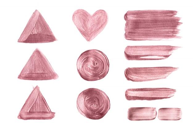 Escova de ouro rosa mão pintado conjunto isolado no fundo branco Vetor Premium