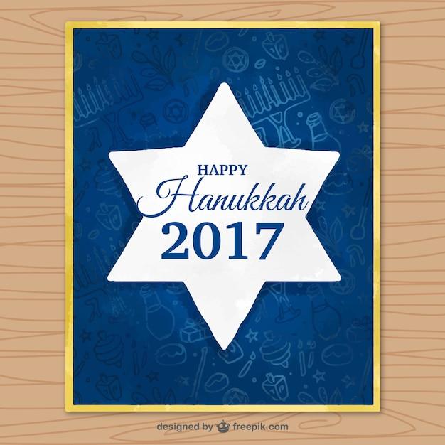 Escuro cartão azul com a estrela de hanukkah Vetor grátis