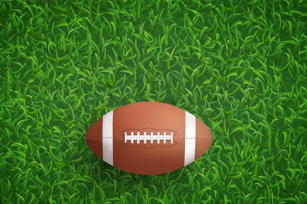 Esfera do futebol americano na grama verde. Vetor Premium