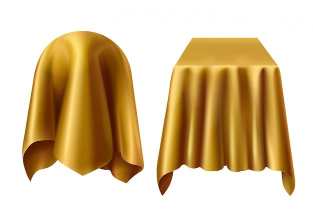 Esfera e caixa cobertas com pano dourado Vetor grátis