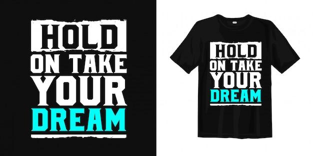 Espere, pegue o seu sonho. design de camiseta inspirada Vetor Premium