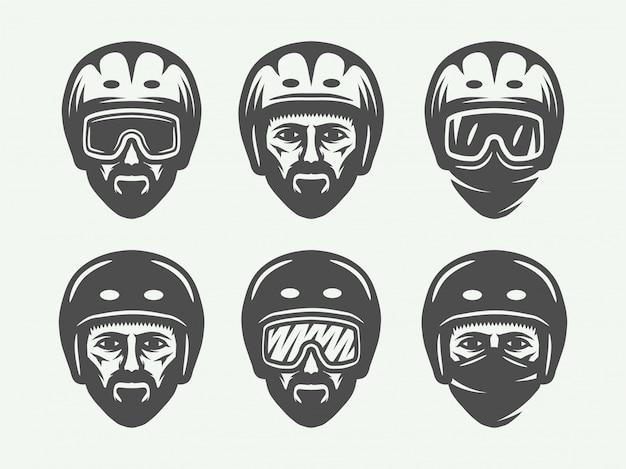 Esqui de snowboard ou logotipos de cabeça de inverno Vetor Premium