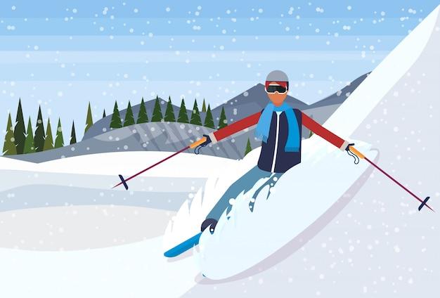 Esquiador homem descendo a montanha Vetor Premium