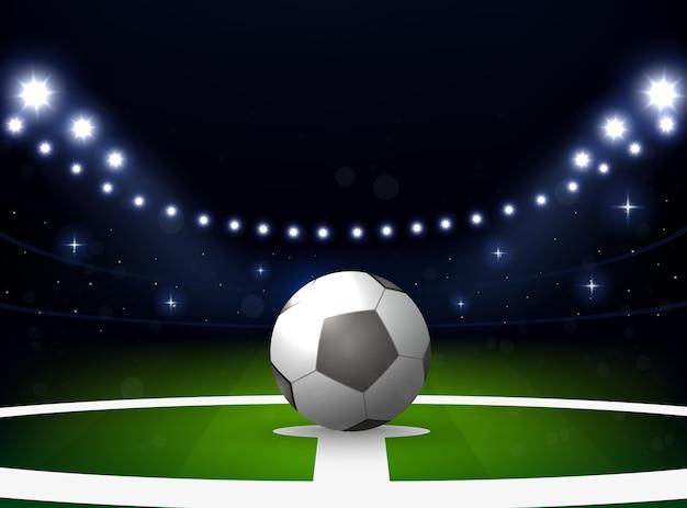 Estádio de futebol com bola e holofotes à noite Vetor Premium