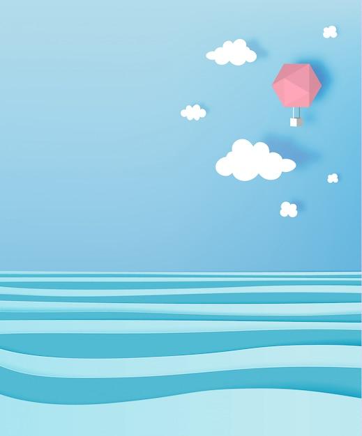 Estilo de arte de papel de balão de ar quente com céu pastel e fundo do oceano Vetor Premium