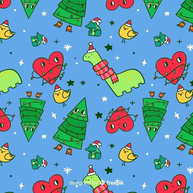 Estilo infantil de padrão engraçado de natal Vetor grátis
