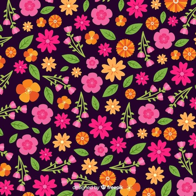Estilo plano de fundo de flores coloridas Vetor grátis