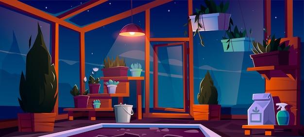 Estufa de vidro com plantas, árvores e flores à noite. Vetor grátis