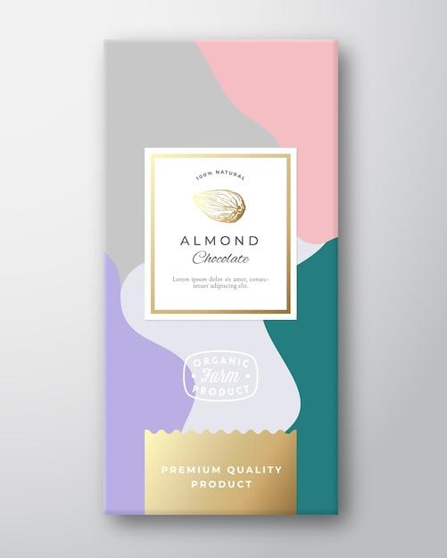 Etiqueta de chocolate de amêndoa. layout de embalagem abstrato com sombras suaves realistas. Vetor grátis