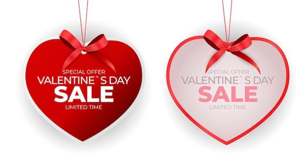 Etiqueta de venda de dia dos namorados coração com laço Vetor Premium