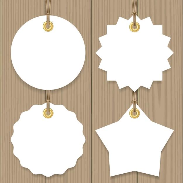 Etiquetas de enforcamento em branco venda com uma seqüência de caracteres mock up definido, redondo, estrela e forma de distintivo. Vetor Premium