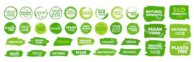 Etiquetas e emblemas alimentos orgânicos, naturais e saudáveis, alimentos frescos e vegetarianos Vetor Premium