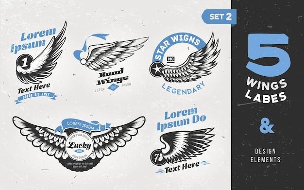 Etiquetas, emblemas, texto e elementos vintage com asas. Vetor Premium