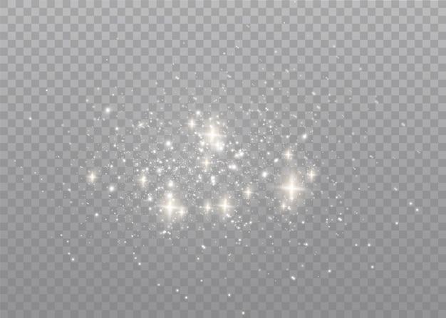 Faíscas de poeira e estrelas douradas brilham com luz especial. Vetor Premium