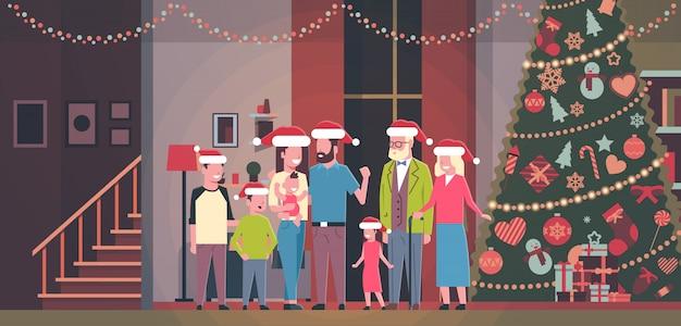 Família de várias gerações juntos em casa perto de árvore de abeto decorada feliz ano novo feliz natal conceito plana horizontal Vetor Premium
