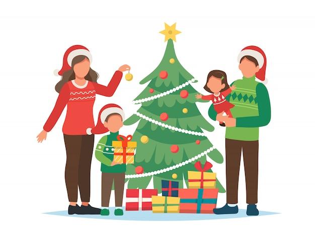 Família decorando a ilustração da árvore de natal Vetor Premium