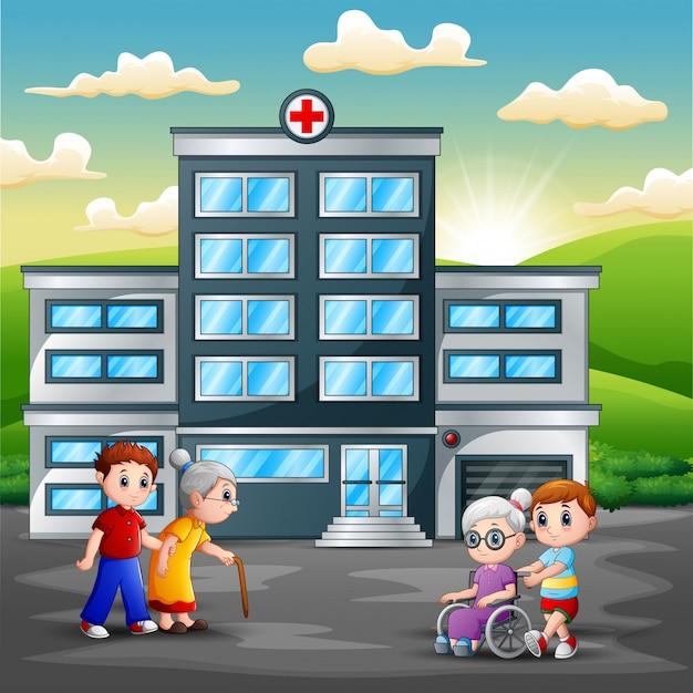 Família em frente ao hospital Vetor Premium