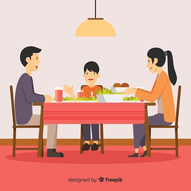 Família plana ao redor da mesa Vetor grátis
