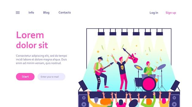 Famosa banda de rock tocando música e cantando no modelo da web do palco. multidão de desenho animado de pessoas perto da cena e acenando com as mãos Vetor grátis