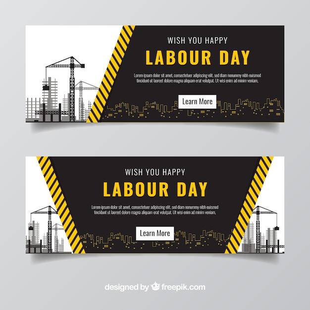 Fantásticas bandeiras do dia do trabalho com construções Vetor grátis