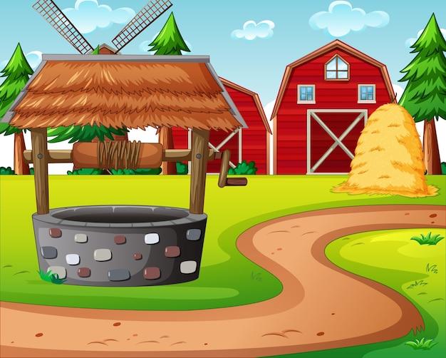 Fazenda com celeiro vermelho e cena de moinho de vento Vetor grátis