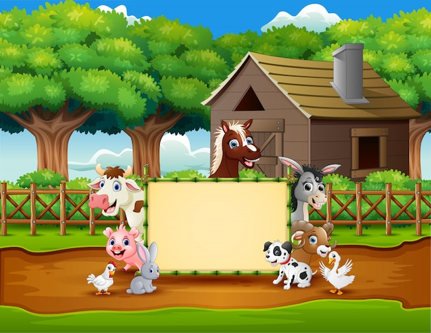 Fazenda de animais dos desenhos animados com um sinal em branco Vetor Premium