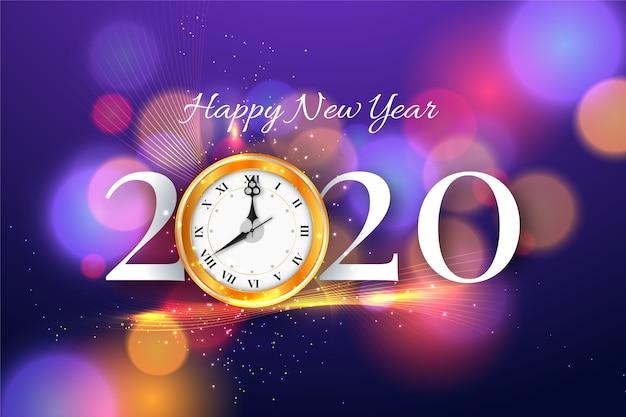 Feliz ano novo 2020 com fundo de relógio e bokeh Vetor grátis