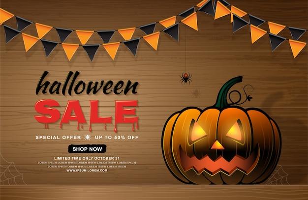 Feliz dia das bruxas venda banner modelo abóbora e teia de aranha Vetor Premium