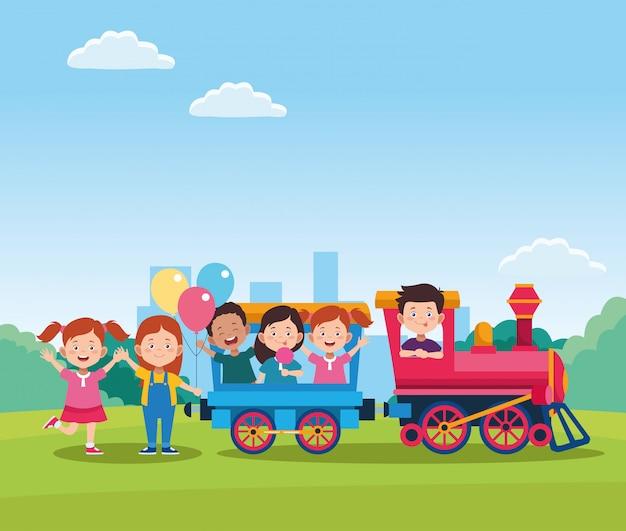 Feliz dia das crianças design com trem com crianças felizes dos desenhos animados nos vagões Vetor Premium