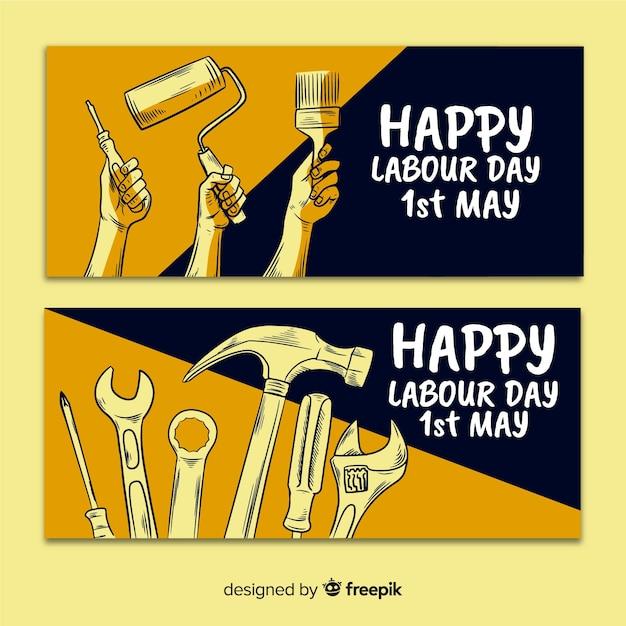 Feliz dia do trabalho mão desenhada banner para web e mídias sociais Vetor grátis