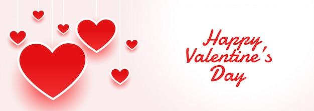 Feliz dia dos namorados banner atraente com corações Vetor grátis