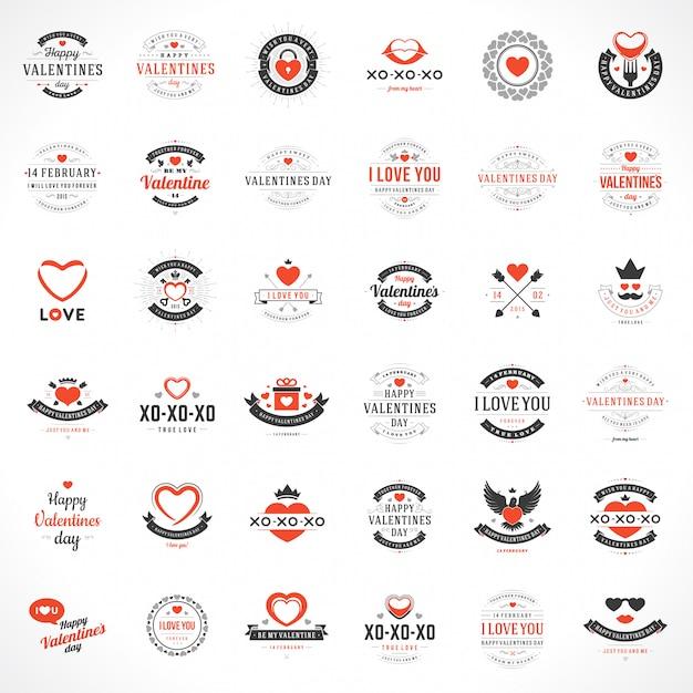 Feliz dia dos namorados cartões de saudações e emblemas tipografia vintage com símbolos de decoração Vetor Premium