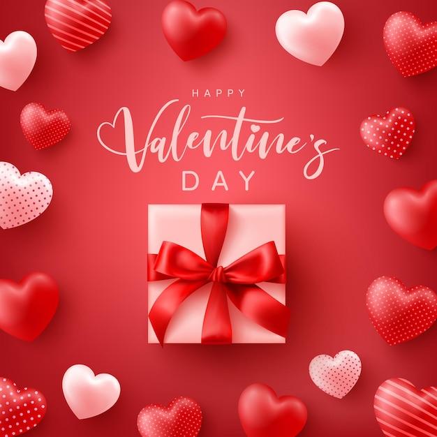 Feliz dia dos namorados pôster ou banner com corações doces e linda caixa de presente em vermelho Vetor Premium