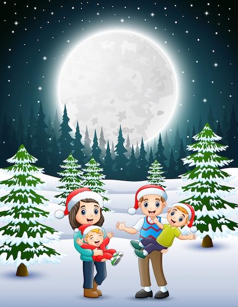 Feliz familly no jardim nevado à noite Vetor Premium
