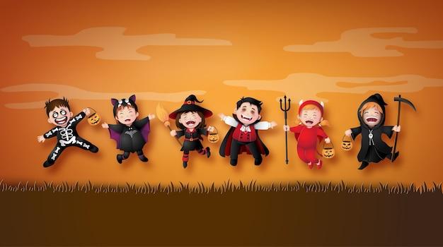 Feliz festa de halloween com as crianças do grupo em trajes de halloween.ilustração de arte de papel Vetor Premium