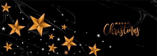 Feliz natal banner preto com estrelas douradas Vetor grátis