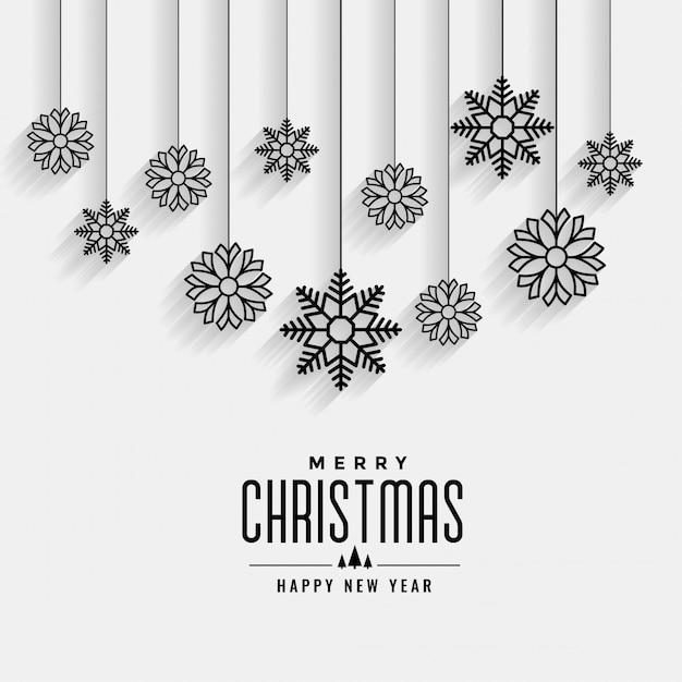 Feliz natal cartão branco com design de flocos de neve de suspensão Vetor grátis