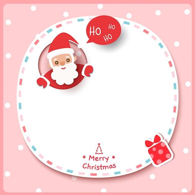 Feliz natal com papai noel e caixa de presente no fundo do quadro rosa. Vetor Premium