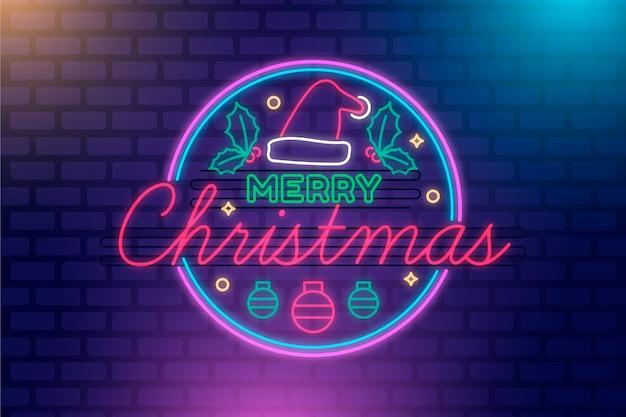 Feliz natal conceito com design de néon Vetor grátis