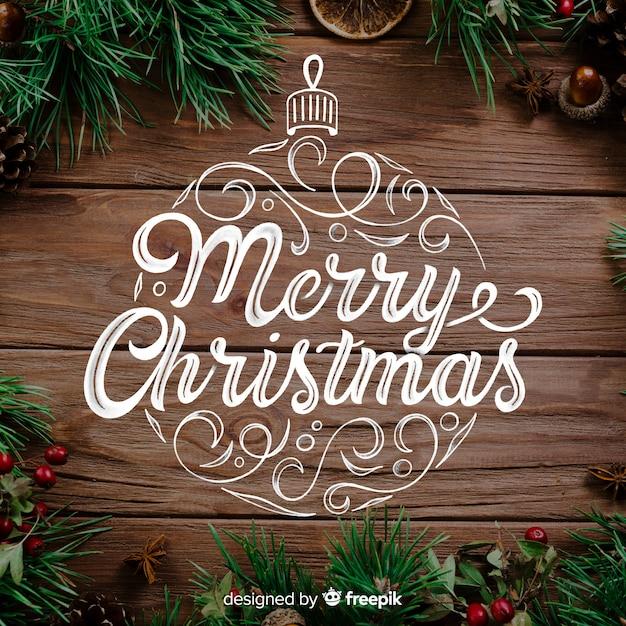 Feliz natal conceito com letras Vetor grátis